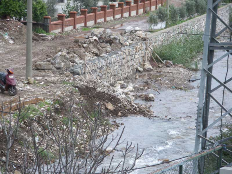 Repairs to the river walls after the flash floods of February 2010