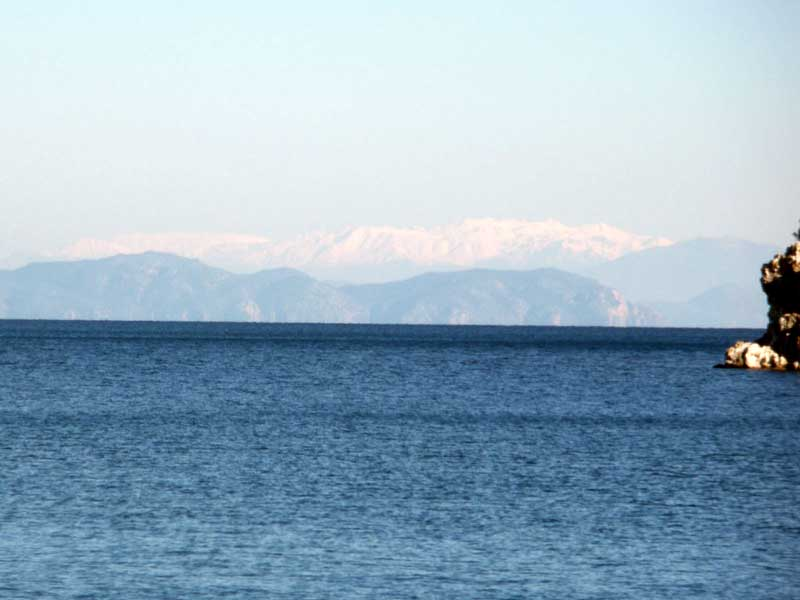 Snow on the distant mountains across the bay