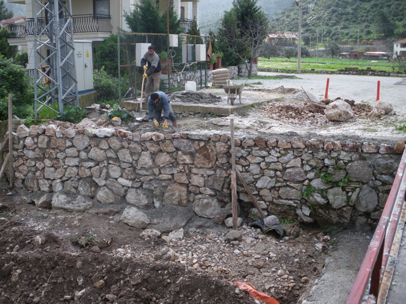 Rebuilding river bank walls