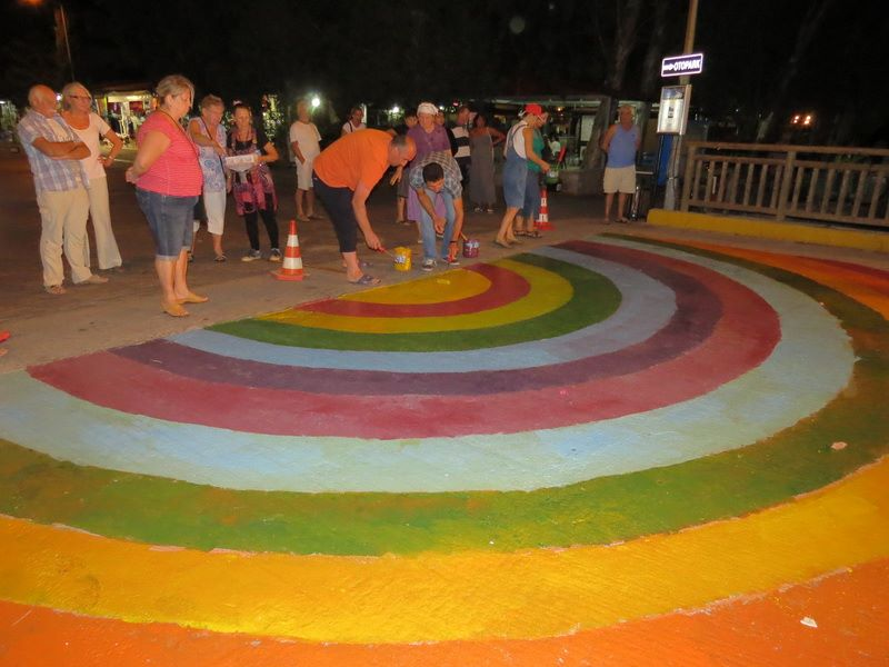 Visitors and locals step up to add their touch to the 'rainbow bridge'