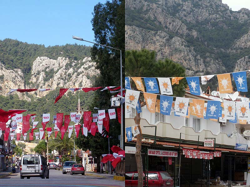 The village festooned with flags of the rival political parties - CHP (left) and AKP (right) - ahead of the upcoming elections