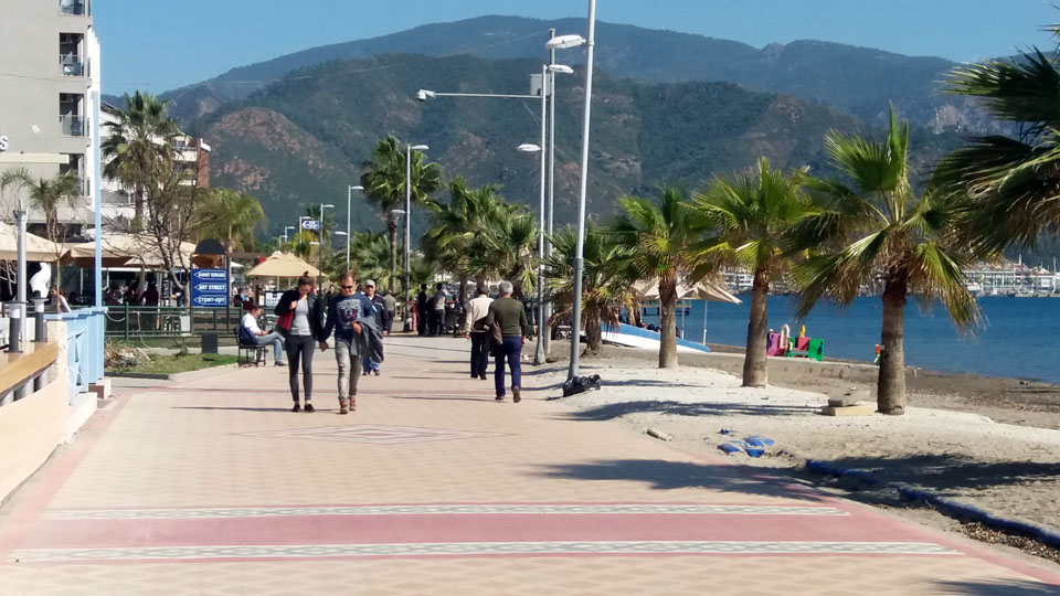 Glorious sunshine brings out the crowds on the promenade in Marmaris